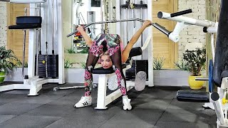 Contortion in gym. Extreme flexible poses.
