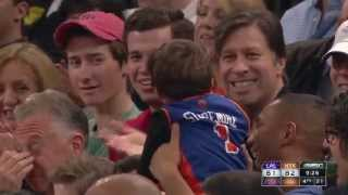 Referee Mike Callahan Gives a Young Knicks Fan a Souvenir