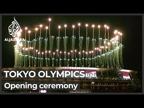 Pandemic-hit Tokyo Olympics open in low-key ceremony without fans