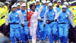 "Olympic Torch who are the ""Men in Blue?"" BBC reports"