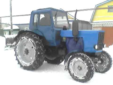 Пуск трактора Мтз 80 зимой в мороз.