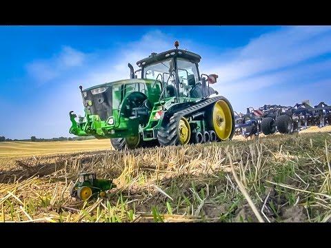 John Deere tractor 8370RT working on a field! Beautiful farming machine!