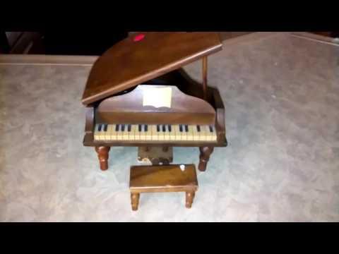 Dad's Haul. Wind Up Mini Wooden Piano Replica