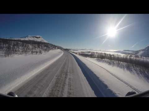 Driving in winter wonderland. Kilpisjärvi, Lappi, Finland.