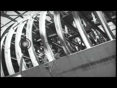 Men working on the construction of the skeleton hull of Fleet Ballistic missile s...HD Stock Footage