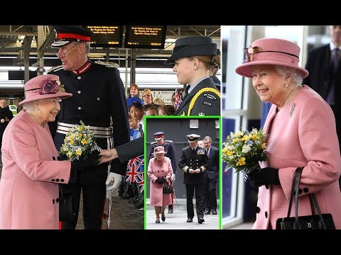 The Queen goes for a splash of Spring colour as she attends ceremony for HMS Ocean in Plymouth.