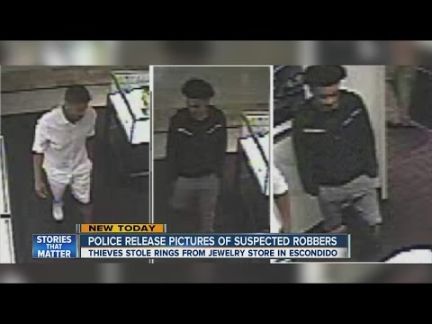Police release pictures of suspected robbers