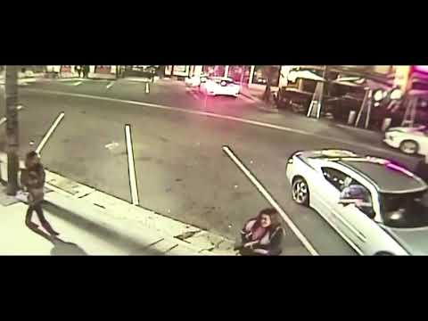 Woman Stabbed While People  Watch