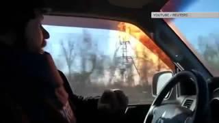 Взрыв газа и обстрелы: съемочная группа Reuters в аду Дебальцева