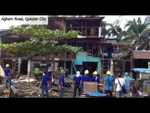 Authorities demolish houses at Agham Road in Quezon City