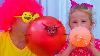 Milusik and papa playing Balloon Shop