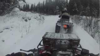yamaha moto4 climbs up in deep snow