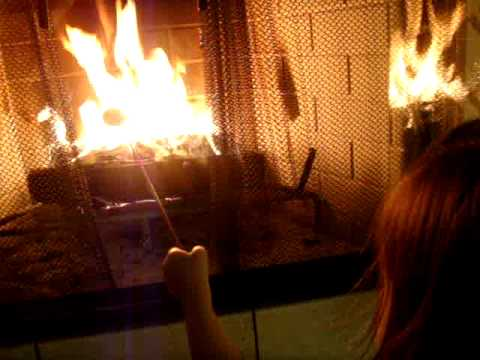 we're roasting marshmallows in the fireplace. LOL - YouTube