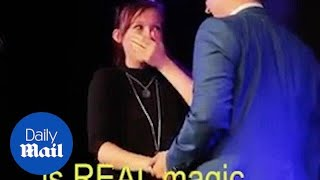 A magician proposes to girlfriend using alphabet spaghetti