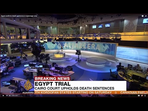 Trial of Mohamed Morsi and Al Jazeera journalists a 'sham', says Egyptian journalist