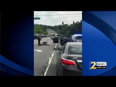 RAW: Gwinnett County police officer kicks man in head during traffic stop