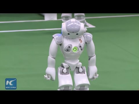 Robots playing soccer at pre-RoboCup competition in Beijing