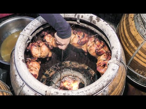 Thailand Street Food. Roasted Chicken in Charcoal Oven. Bangkok