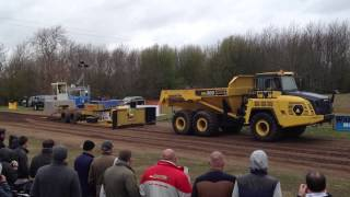 Dump truck pulling sledge at tractor pull