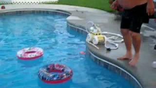 Fat Man Gets out of Swim Ring  رجل سمين يخرج من كفر السباحة