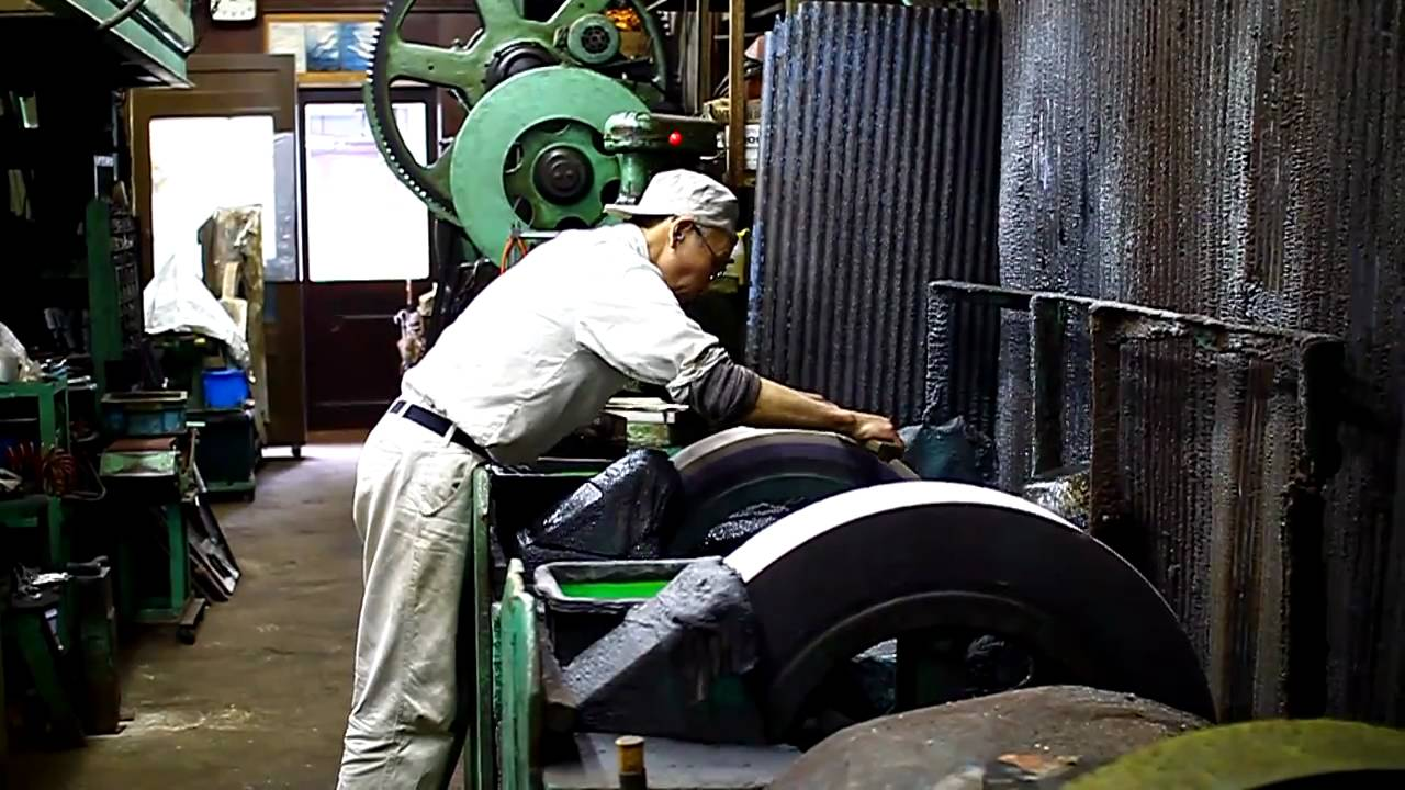 Ashi Hamono Sharpening Knives On A Large Water Stone