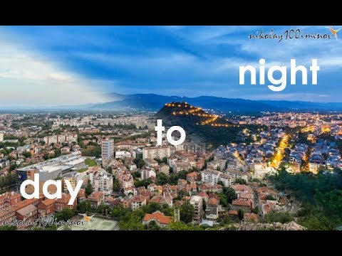 Moving day to night timelapse of a Plovdiv cityscape.