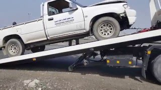 Recovery van lifting damaged vehicle in UAE