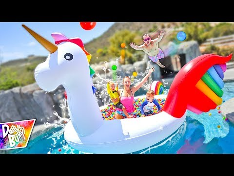 Giant Rainbow Unicorn FLOATING BALL PIT Swimming Pool Party!