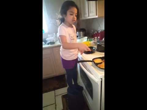 Madyson making breakfast