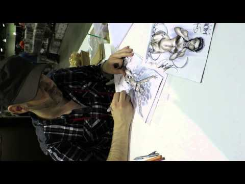 J Scott Campbell signing my Fathom and Soulfire retail incentives, Calgary Comic Con 2014