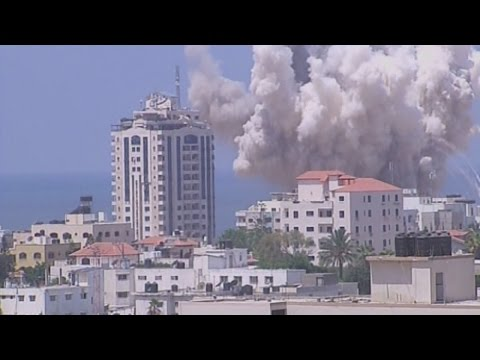 Smoke rises above city as Israel strikes Gaza