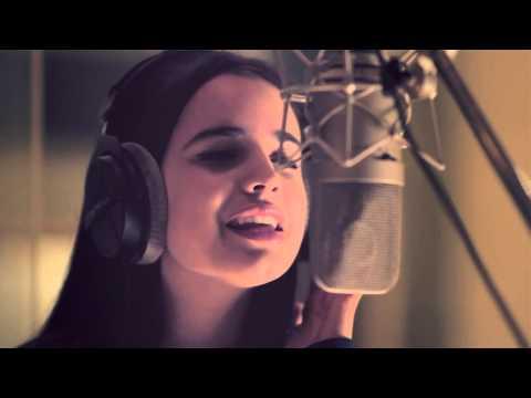 Sofia Carson singing UNA FLOR