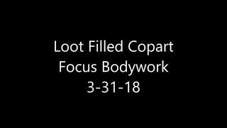 Working on the Loot Filled CoPart Focus Trunk area. 3-31-18