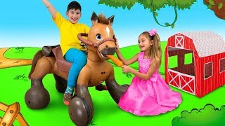 Sasha plays with a ride on a horse toy and goes to camp