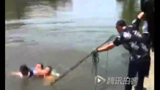 Woman with swimming skill plays dead by floating like drowned corpse in river