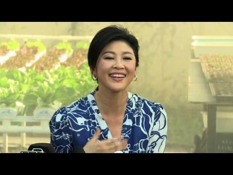 Ex-premier Yingluck takes Thai politics to the garden