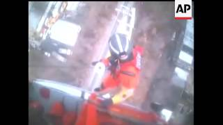 The Coast Guard rescued two workers who were trapped atop a utility pole for more than two hours in
