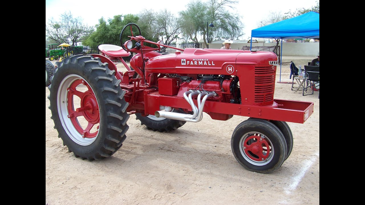 modified ford v8 powered 1951 farmall h pulling the sled. Black Bedroom Furniture Sets. Home Design Ideas
