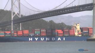 Cargo Ship leaving Port of Oakland under the Bay Bridge