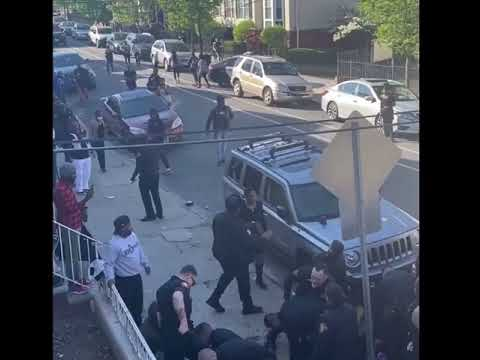 Jersey City police can be seen using pepper spray and batons to break up a brawl that broke out between to men.