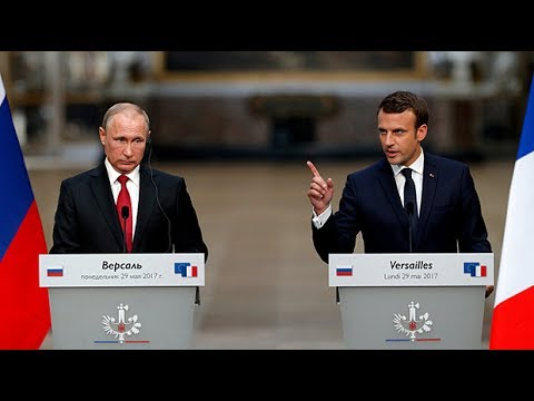 Macron slams Russian media 'lies' during exchange with Putin