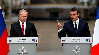 Macron slams Russian media 'lies' during exchange with Putin