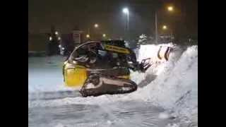 Snowplowing in Waterloo Ontario Canada with 2014 New Holland C232  CTL & 9' Plow Snowman.ca