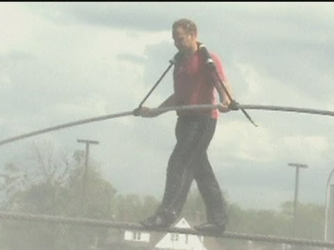 High Wire Artist Walks Wet Tightrope In Wind And Rain To Prepare For Niagara Falls