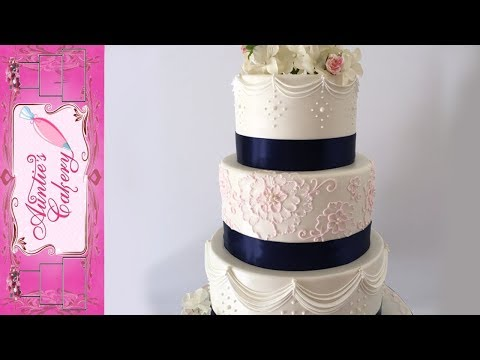 Pastel Pink and Navy Blue decorated Wedding Cake