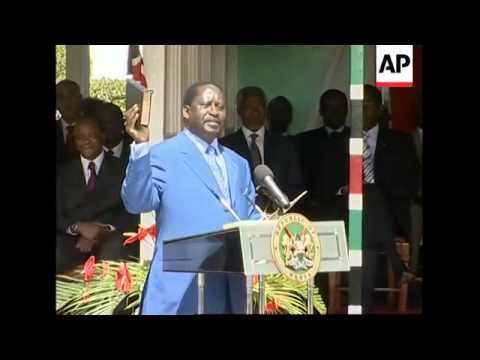 AP pix President Kibaki swears in opposition leader Odinga as PM