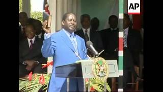 AP pix President Kibaki swears in opposition leader Odinga as PM