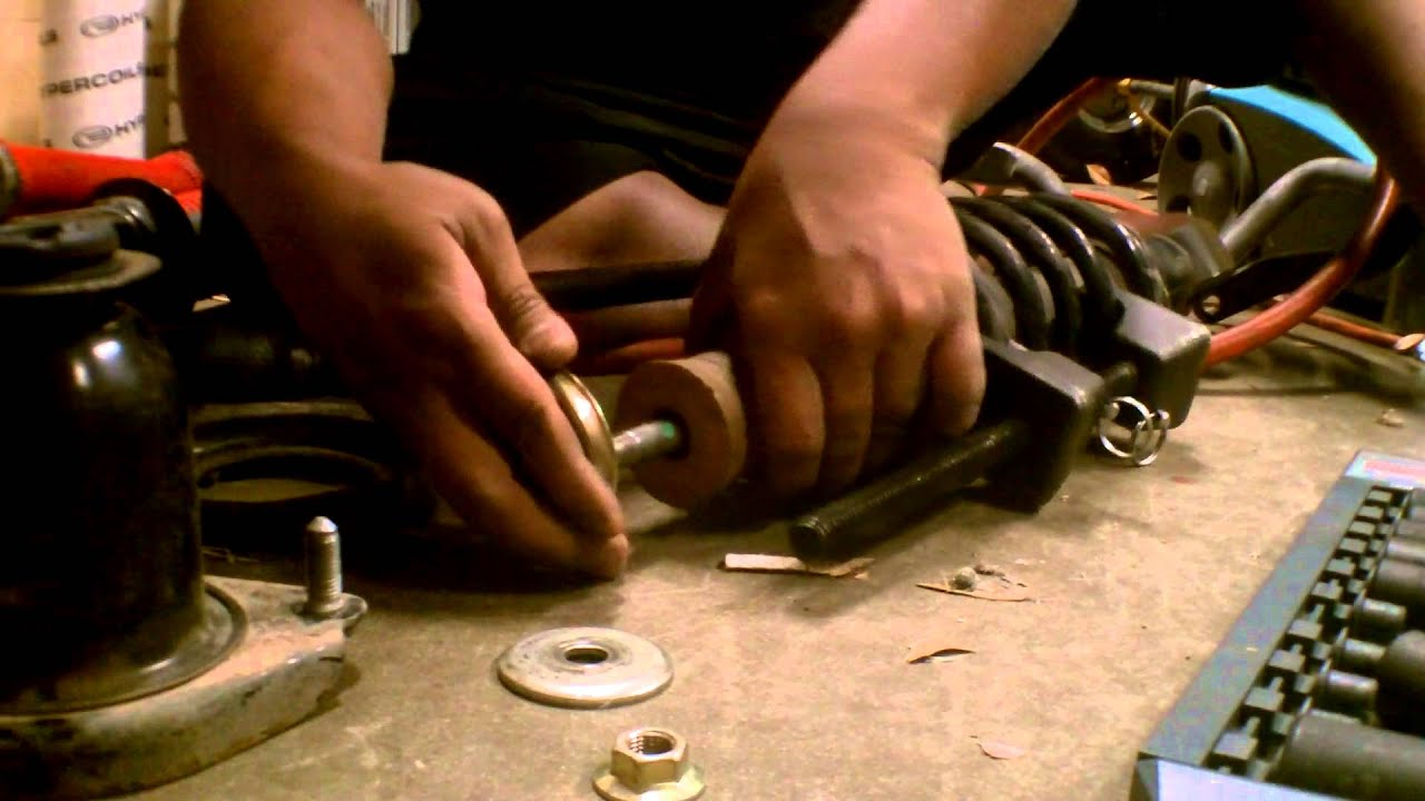 Toyota corolla rear strut disassembly and reassembly 2003 2008 youtube