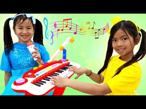 Emma & Jannie Pretend Play with Guitar and Drums for Surprise Birthday Party mp3