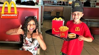 Kids pretend play working at McDonald's with surprise toys